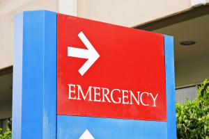 sign at the hospital points towards the emergency room entrance.